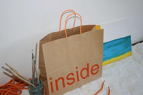 bolsas de papel para comercios con asa rizada